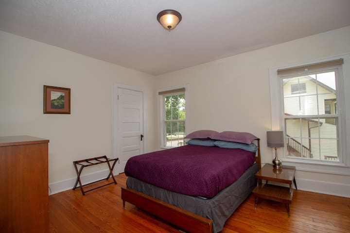 A comfortable full-size bed complements a room with two spacious closets and lots of natural lighting.
