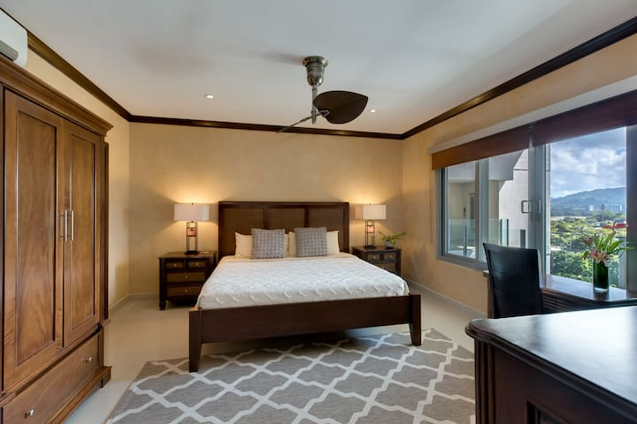 Second master bedroom with desk.