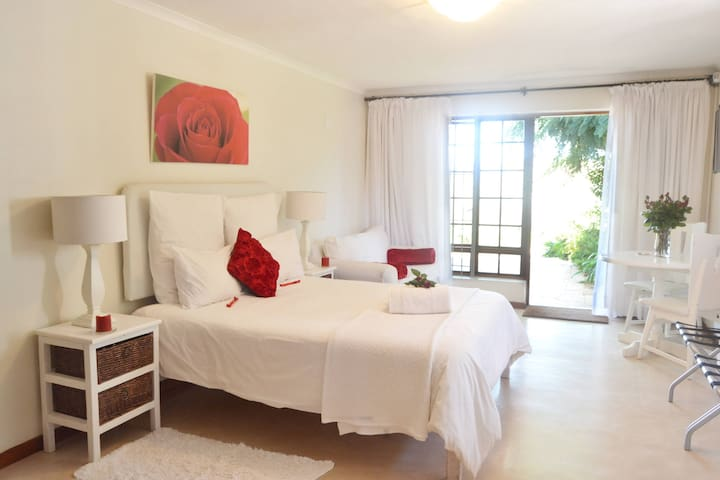 The Red Rose Room 4 is very private, cool in summer, spacious and decorated with simplicity and red roses.  No stairs and parking right outside the room. Private patio with barbecue facilities and view.