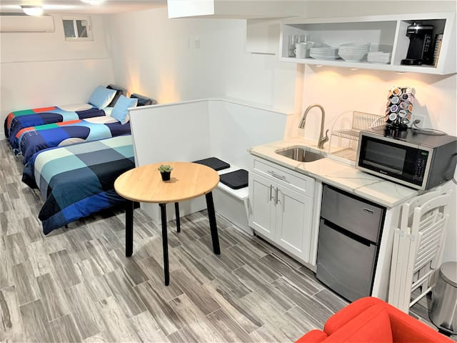 The kitchenette is equipped with a microwave, mini-fridge, and all the kitchenware, glassware and dishware necessary for a small party (there is no oven, stove or burner).