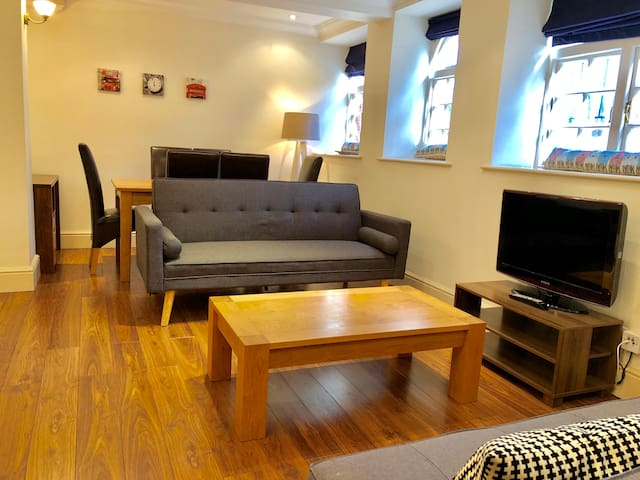 Spacious living room with 2 sofa beds, dining area and fully equipped kitchen