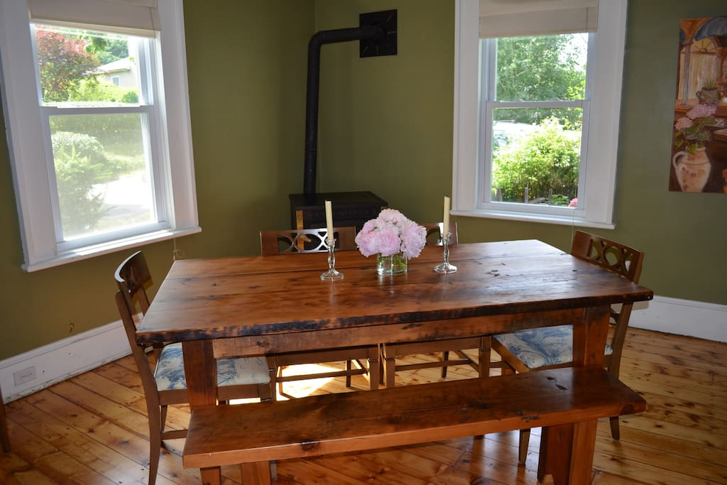 Light-filled dining room seats six at our farmhouse table (high chair available).