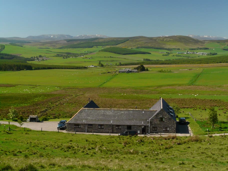 Steading cottages with views to the Cairngorm mountains