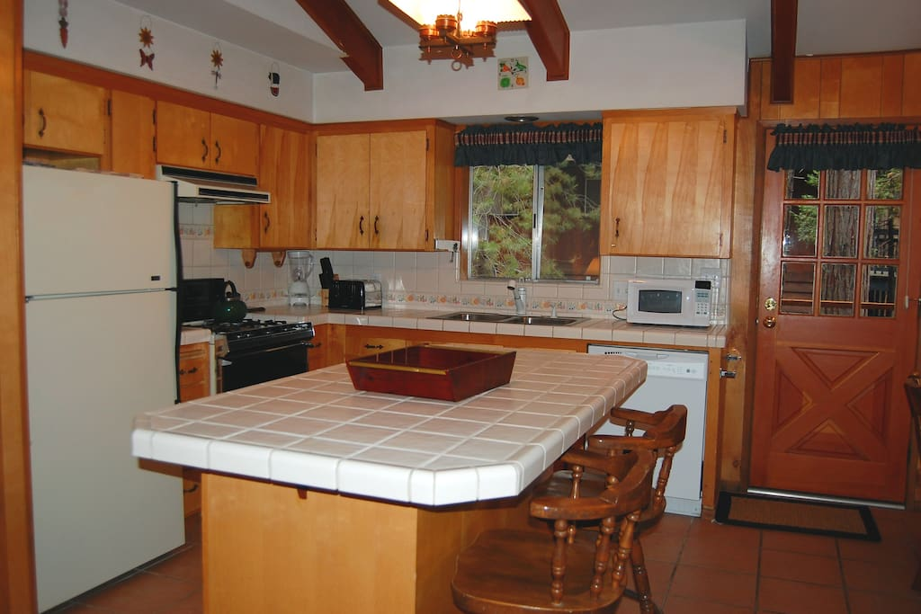 Kitchen with dishwasher and gas stove