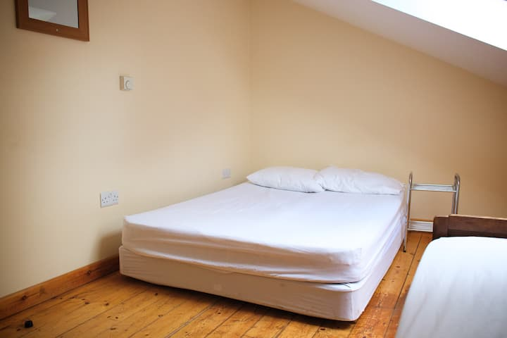 Comfortable bedroom with double and single bed.