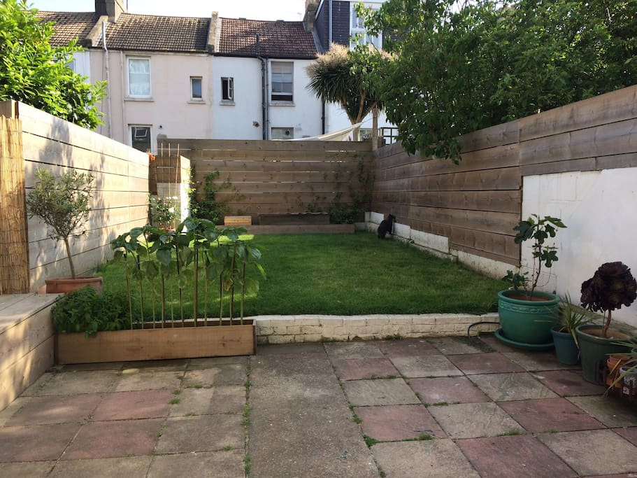 South facing garden with BBQ and outdoor seating