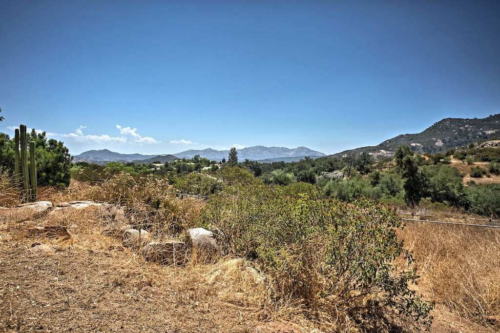 The house sits on a 3-acre property and is surrounded by the mountains.