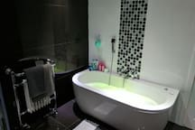 Shared Bathroom with Whirlpool Bath and Separate Shower