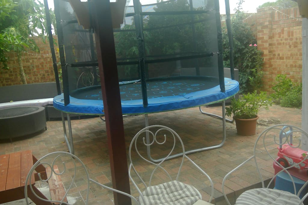The backyard comes with a large trampoline, childrens water table, bikes, slides, jumperoo's and much more for all ages