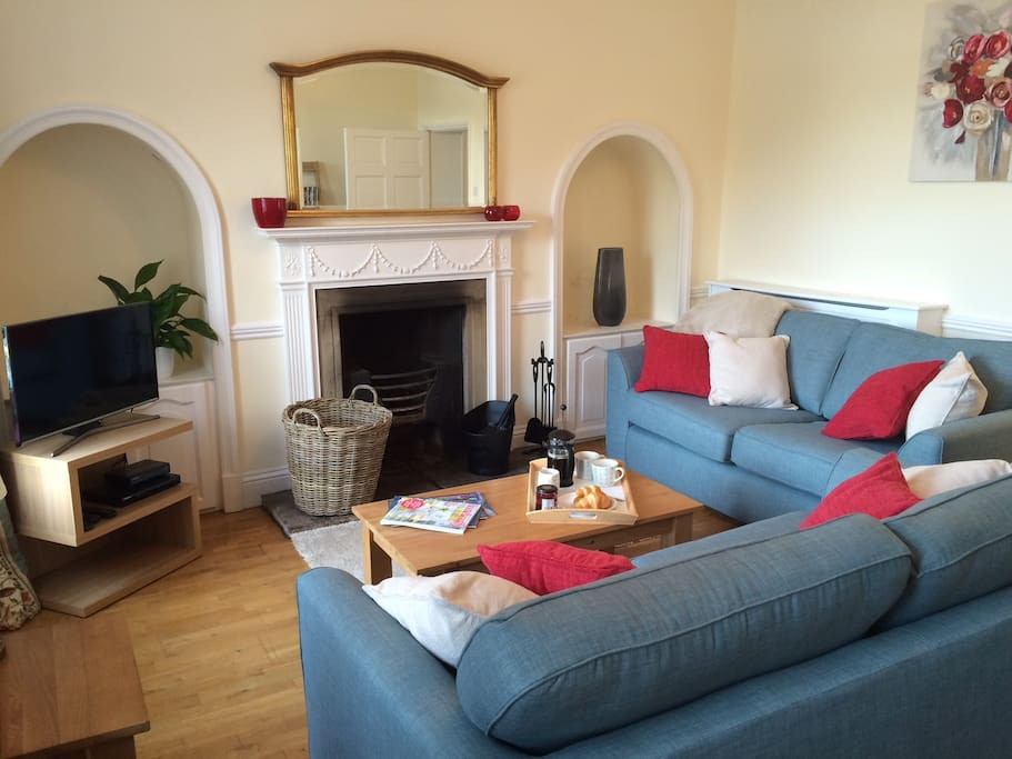 Spacious sitting room overlooking The Green with log burner