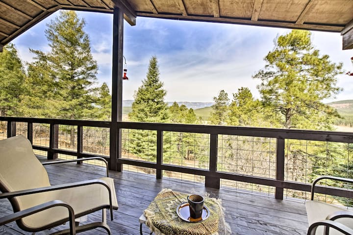 This 4-bedroom, 3-bath vacation rental cabin features a balcony and lower patio.