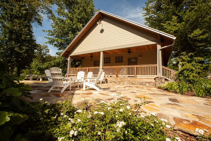 Back deck/porch with flagstone patio and furniture