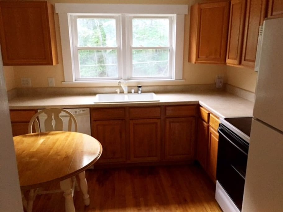 Full kitchen with microwave.