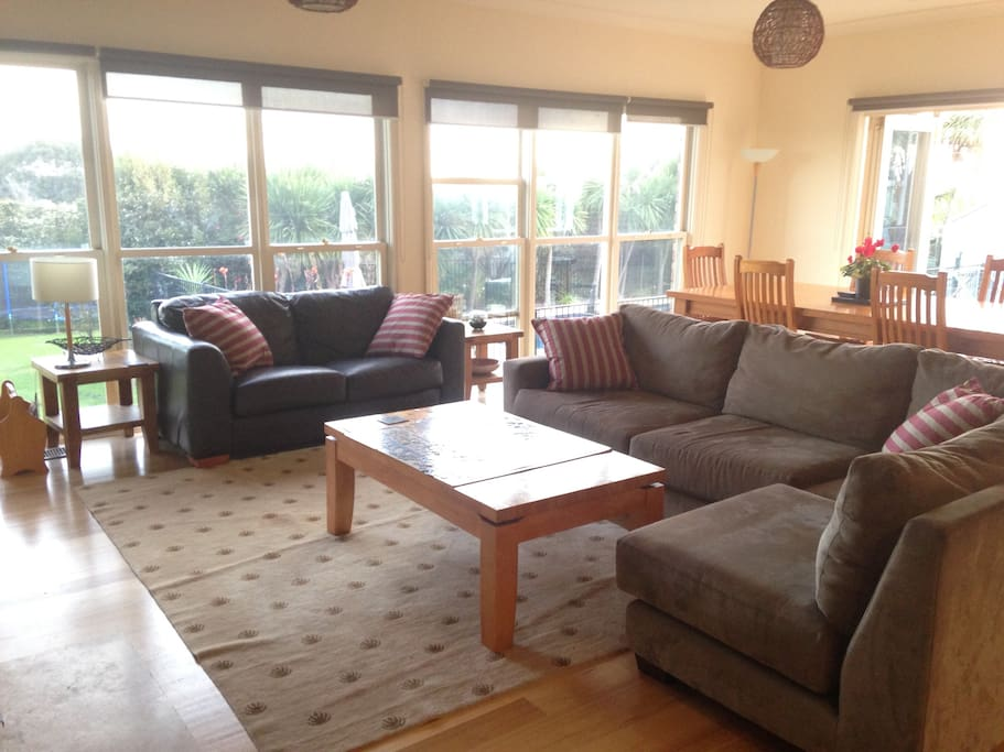 Living room leading to garden and pool