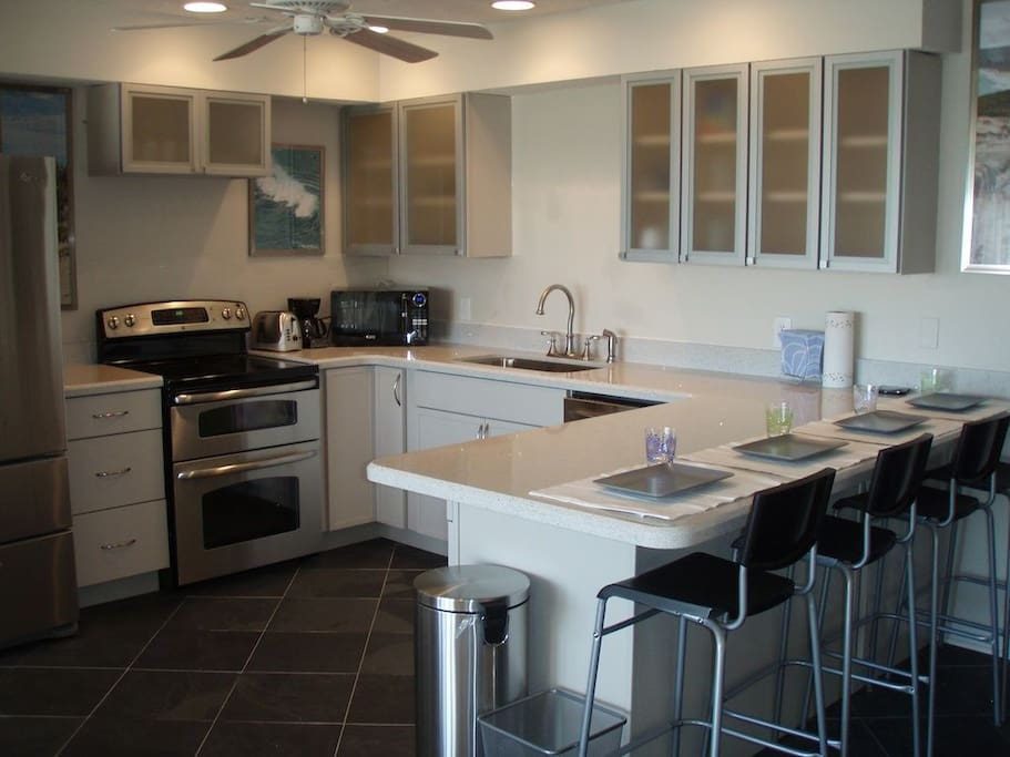 State-of-the-art kitchen with Silestone countertops and stainless steel appliances.
