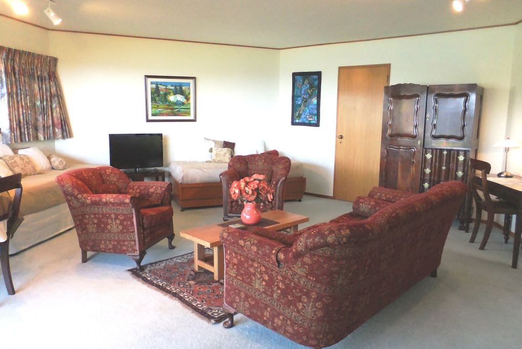 Lounge with lounge suite plus 2 single beds