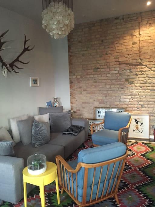 living room w/ brick wall