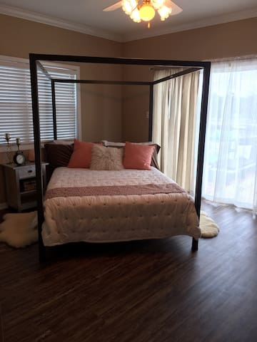 Full sized bed with attached bath. Access to the deck from this room.
