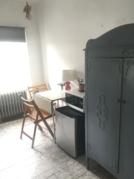 Purple hutch for your belongings and the kitchenette area