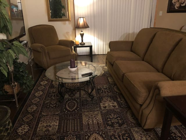 Comfy recliner and cushy sofa; 50 inch TV perfect for movie watching. There's a patio with table and chairs for sipping your morning coffee.