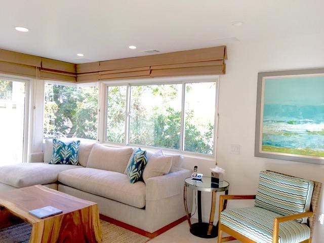 Coveted upgraded villa, steps to the water, intimate view decks.