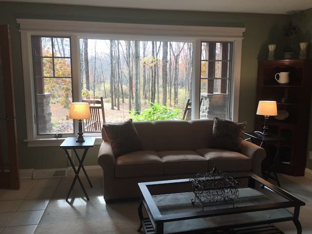 Living room with beautiful view of property. Queen size sofa-sleeper.