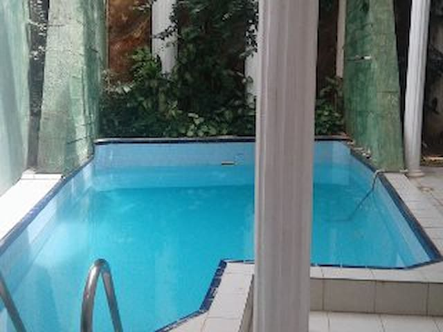 The indoor pool at the Studio Apartment