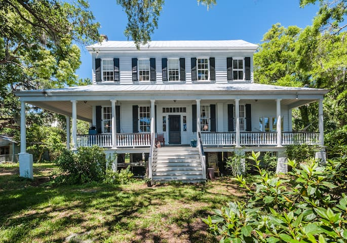 This house faces the Bohicket river. This picture is of front porch where you can spend hours relaxing and soaking the beauty and shade from the live oaks.