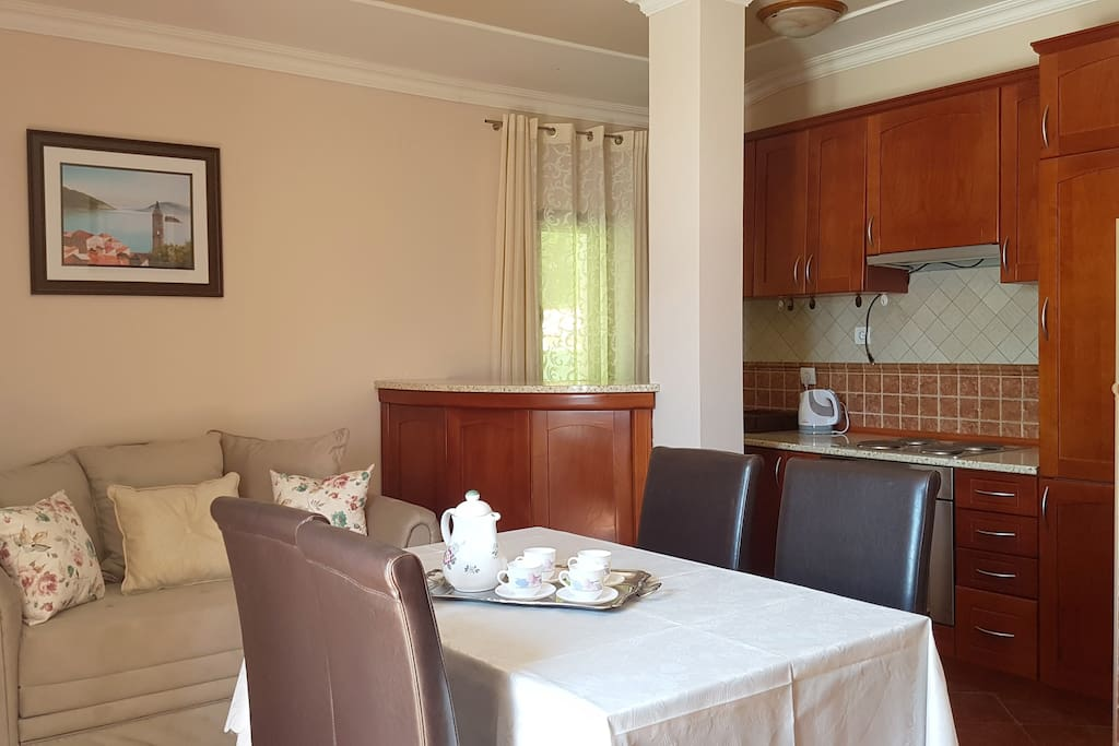 Full equiped kitchen and dining table, and sofa where you can relax watching the TV