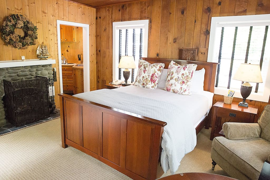 Our Queen Studio features a wood-burning fireplace; fully-appointed kitchen with a full-size fridge, cooktop, kitchen sink and Keurig coffee machine; and a private bathroom with stand-up shower and rainfall showerhead.