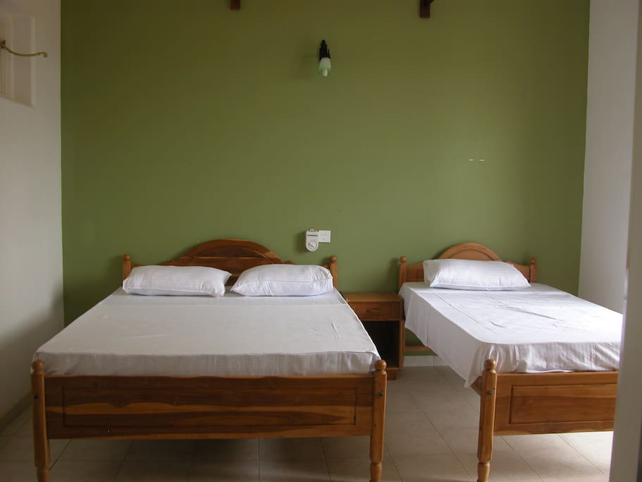 green gold room with 2 beds