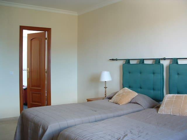 bedroom 1, with door to en-suite