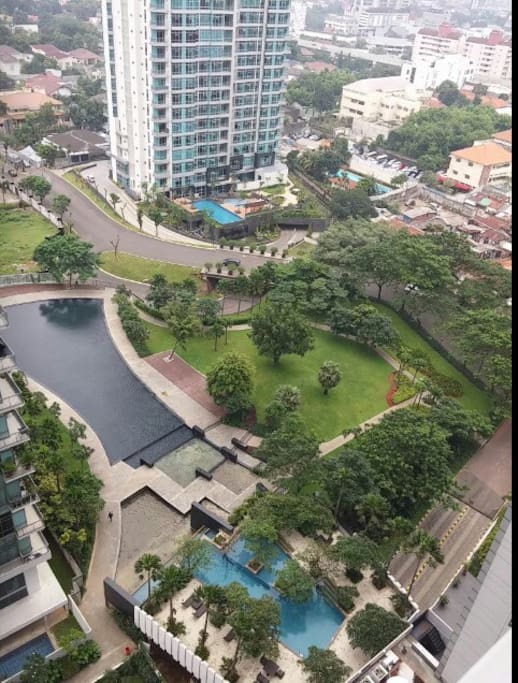 View from the roof of building with jogging path and swimming pool in this picture.