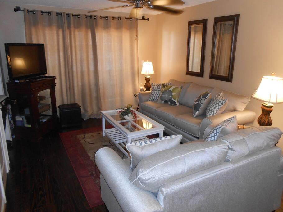 """Living Room w/ Queen Sleeper Sofa, 43"""" TV."""