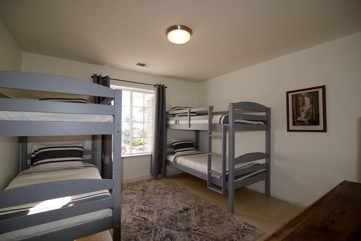 A bunk room for all ages. Equipped with a smart tv for that sometimes needed extra entertainment.