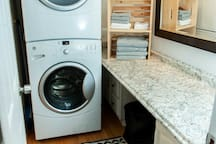 Huge vanity area to get ready in the morning. Full size washer and dryer, with soap provided for you!