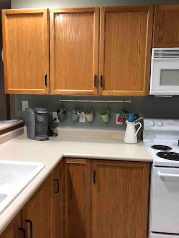 Well stocked kitchen with Keurig coffee maker
