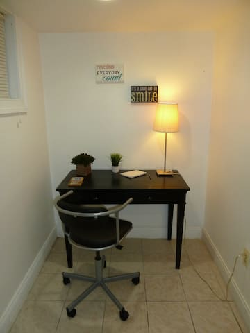 There is a desk and a chair in the bedroom