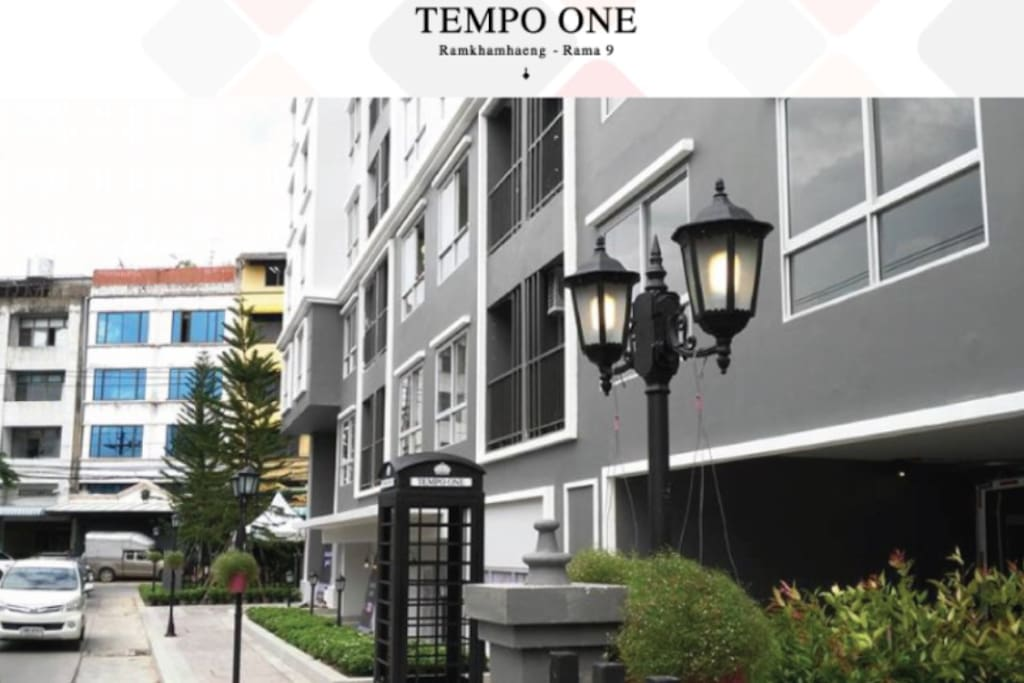 In front of 'Tempo One' Condominium. Low-rise building with small number of units behind The Mall 2 on Ramkamhaeng 12. Less than 5 minutes walk from Ramkamhaeng Rd.