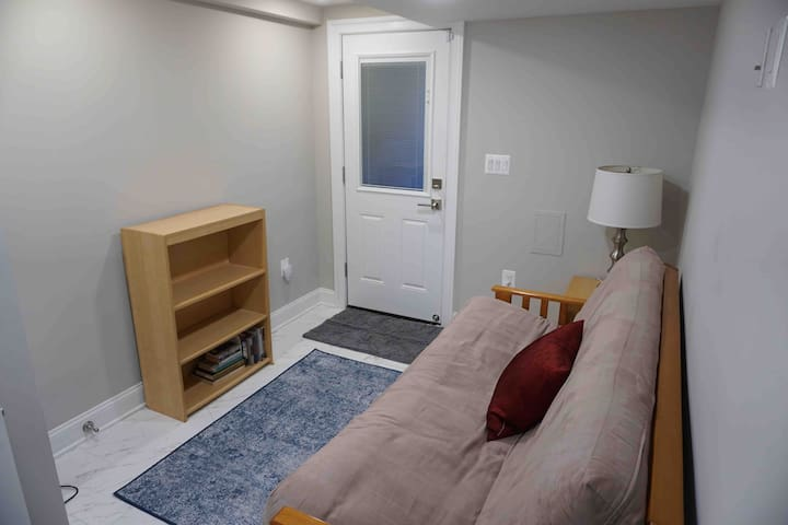 Bedroom #2 - futon folds to double bed. Private back entrance accessible from off-street secure parking space
