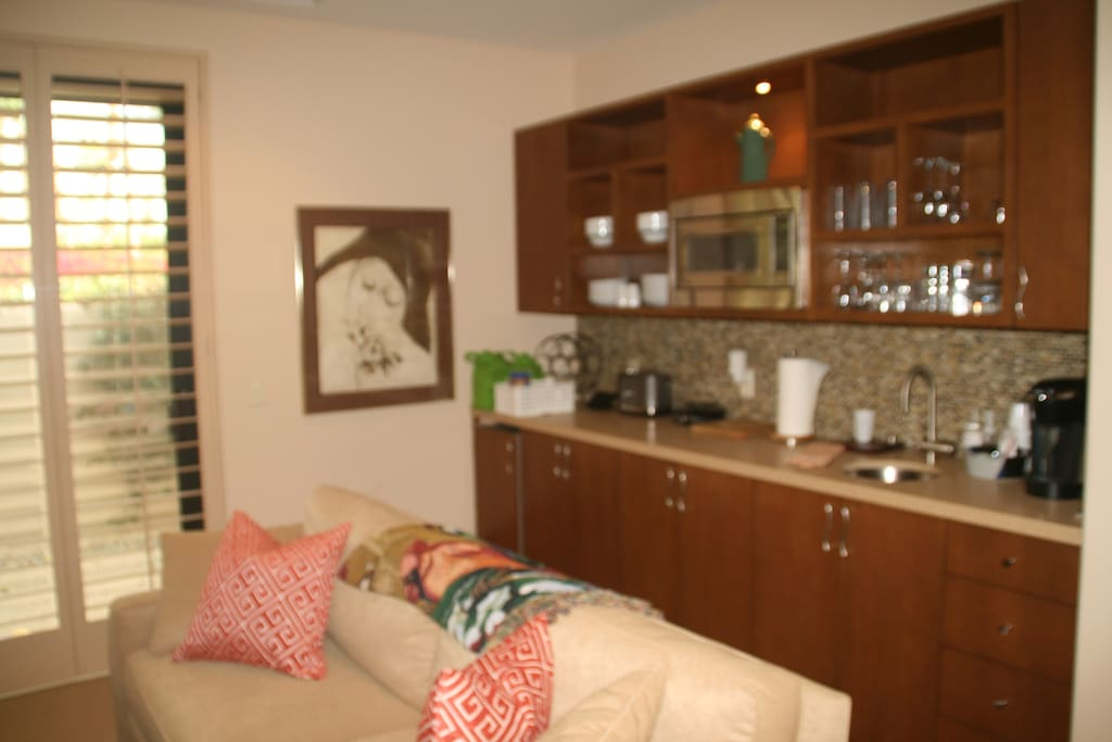 Living Room with Breakfast Bar, small refrigerator,toaster oven and one burner electric stove