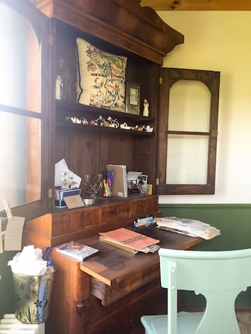 Beautiful antique desk from the 1800s serves as a nice workspace or writing area.