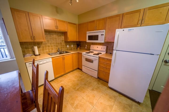 The condo includes a fully-equipped kitchen and dining area, where you can enjoy meals with friends and family in privacy