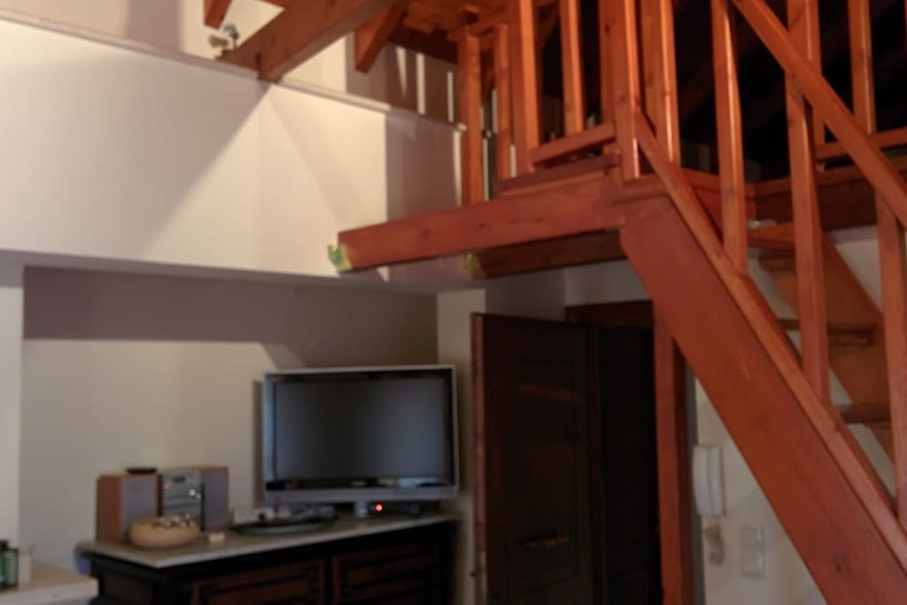 The entrance and the stairs to the main bedroom (attic)