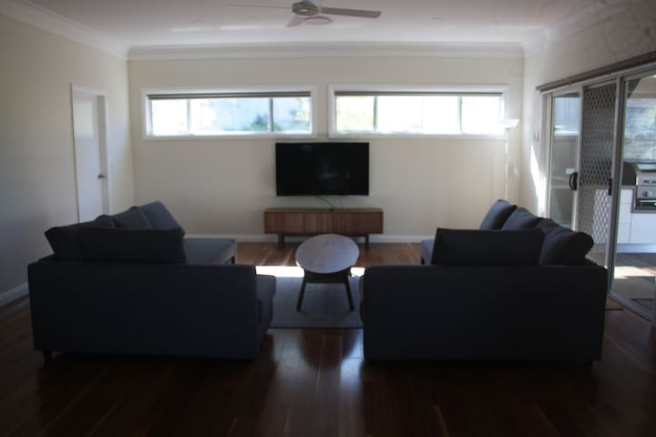 The Living Room gives  access to the BBQ area. It includes two fold out sofa beds for extra guests if required after special arrangement with the host. Netflix is available on this TV only.