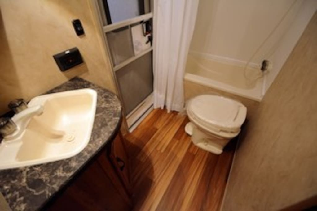 Bathroom complete with a shower and bath and convenient door to come in directly from outside