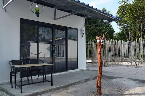 Triple room with garden view (Aircon & Hot Shower)