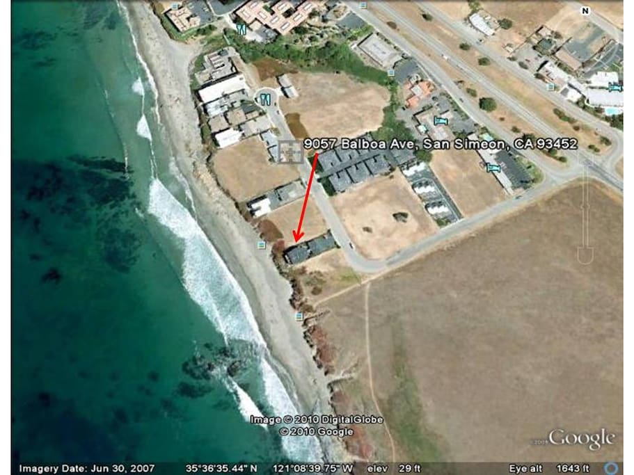Here is a photo I grabbed from Google Earth.  It shows the condo complex (four ocean front condos).  You can see worl-famous Highway 1 (Pacific Coast Highway) going by diagonally to the right.  Hearst Castle is just two miles north on HWY 1.