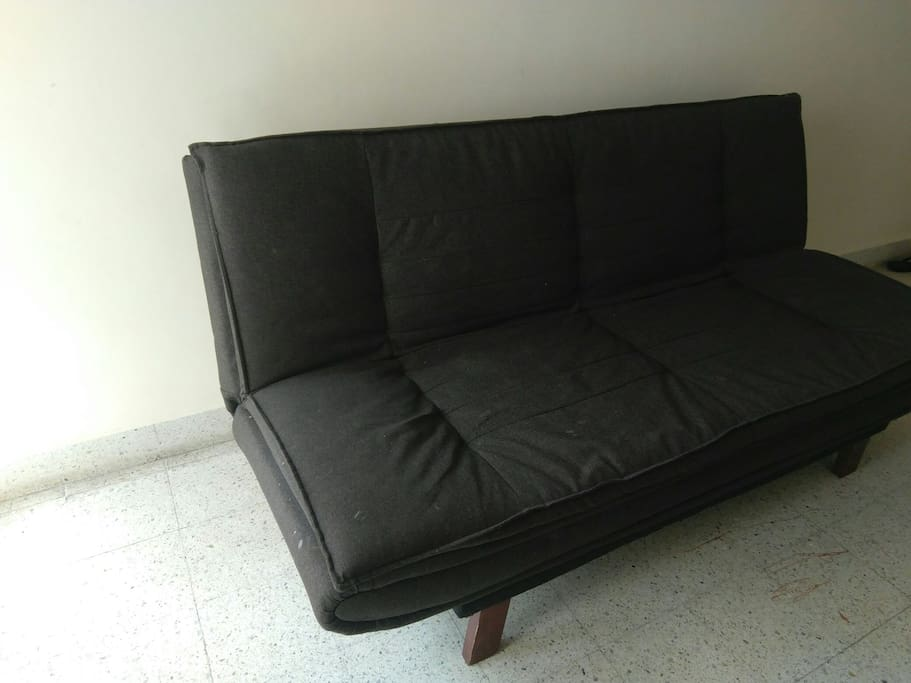 sofa cum bed, opens to a fully flat bed. comfortable for one, cosy for two ;)
