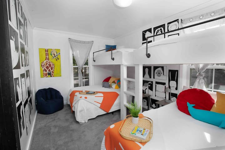 The Doodle Room! With artwork from a local artist, the room is not lacking any character. This is the perfect kids room as it sleeps 6.